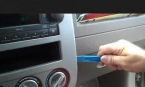 remove the trim panel on Jeep Compass