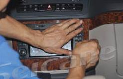 1. Detach the outer frame of the original CD player