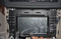 12. Fasten the new Seicane radio with 4 screws and install the frame back