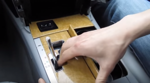 3. Remove the panel beneath the brake with your hands