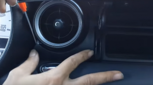 4. Open the glove box compartment, and remove the panel inside shown as the picture.