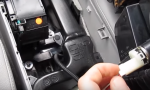 6. Unplug the connector at the back of the panel