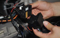 9. Insert the plug of the car into the socket of unit