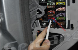 7. Pry the decoration panel beside the driver's seat, change fuse from 5A TO 10A.