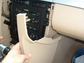 Remove console side panels on both driver and passenger sides