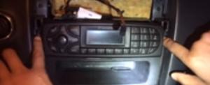 Remove the screws holding the original car radio