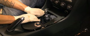 Remove the trim panel under the brake with your hands