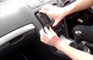 Remove the panel on the radio with your hands