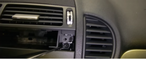 Remove two screws holding the radio with a screwdriver