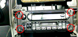 Remove 4 screws which hold the factory radio in place