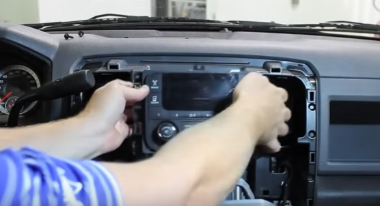 6. Gently lift the radio away from the dashboard and disconnect the factory wire harness from the back of the radio 2013 2014 2015 Dodge Ram 1500 2500 3500 4500 Stereo Radio Sound System essential tutorial on a 2013 2014 2015 dodge ram 1500 2500 3500  at readyjetset.co