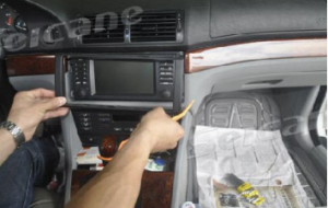Use a plastic trim tool to remove trim strip