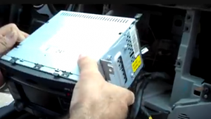Gently remove the original radio from the dash