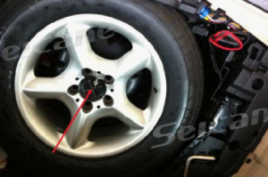 Remove screws in the spare tire in the trunk