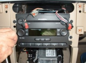 Remove screws securing radio to the vehicle