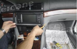 Use a plastic trim tool to remove trim strip