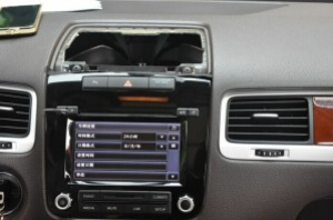 Remove the panel above the original car radio