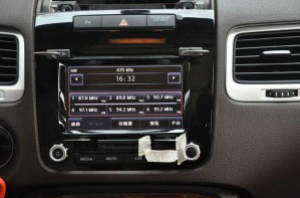 Take down the two buttons of the original radio