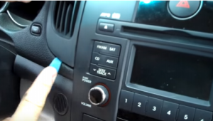 Pry the left air conditioner vent with a lever, and then remove it