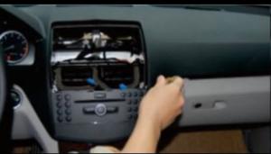 Remove the screws on the original radio