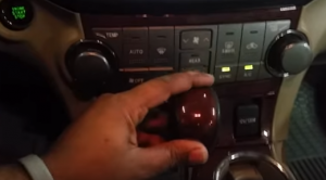 Move the shifter lever so as to get access to the bottom A/C panel below the radio
