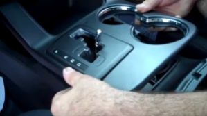 Remove the cup holder by pulling them upward