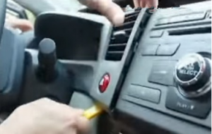 Remove the automotive oil table top panel with plastic knife
