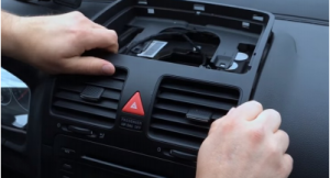 Remove the air conditioner vent with your hands