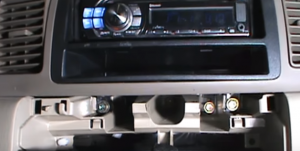 Underneath the original car radio, there are four screws, just remove them so as to take out the original car radio