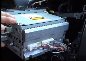 Gently pry around the side of bottom trim panel and take out the original radio