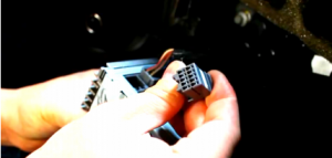 Disconnect the smaller harness on the behind of the original car radio